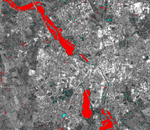 Sentinel-1 data for York overlaid in red with Pixalytics flood mapping layer based on Giustarini approach for the December 2015 flooding event. Data courtesy of ESA.