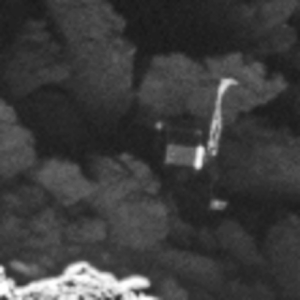 Close-up of the Philae lander, imaged by Rosetta's OSIRIS narrow-angle camera on 2 September 2016 from a distance of 2.7 km. The image scale is about 5 cm/pixel. Philae's 1 m-wide body and two of its three legs can be seen extended from the body. Image courtesy of ESA/Rosetta/MPS for OSIRIS Team MPS/UPD/LAM/IAA/SSO/INTA/UPM/DASP/IDA.