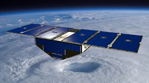 Artist's concept of one of the eight Cyclone Global Navigation Satellite System satellites deployed in space above a hurricane. Image courtesy of NASA.